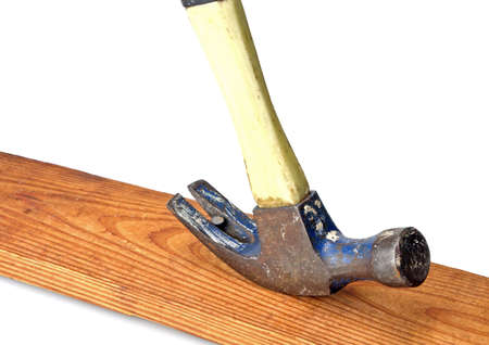 Old hammer pulling nail from piece of wood Stock Photo - 2870746