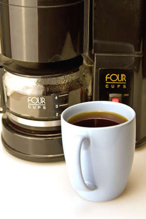 maker: Fresh brewed coffee and black coffee maker Stock Photo