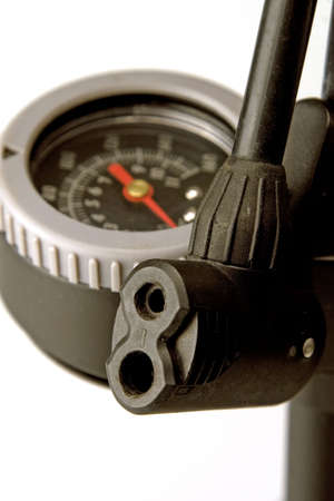 inflating: Close-up of bicycle gauge and focus on nozzle from pump Stock Photo
