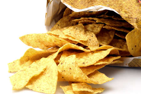 Fresh bag of yellow corn chips waiting for cheese
