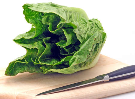 Freash green romaine lettuce cutting board and knife Stock Photo