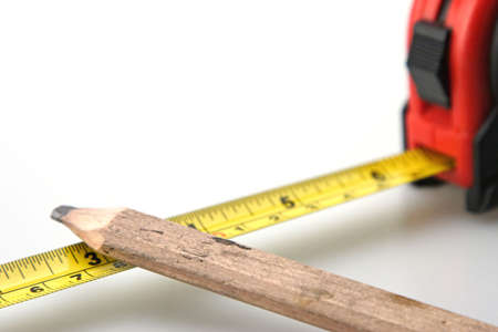 architect tools: Pencil and Black and Red Tape Measure White Background