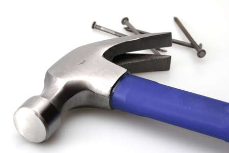 Blue hammer and nails for home construction Stock Photo