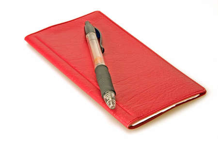 Red check book and pen on white background Stock Photo