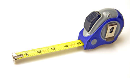 Blue and gray tape measure yellow rule in inches