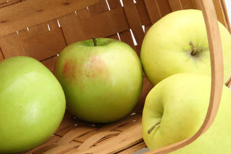 Weaved basket close up of green apples