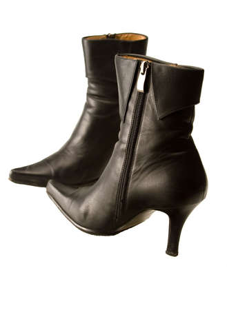 Black high heeled boots on isolated white background