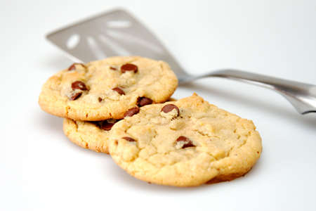 Out of focus spatula and chocolate chip cookies