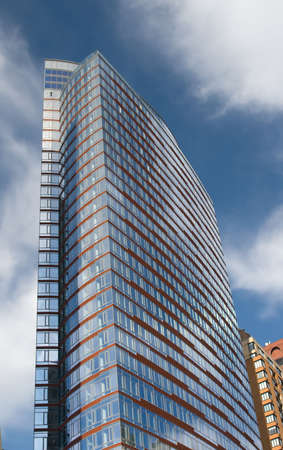 Tall Glass highrise skyscaper reaching into the sky Stock Photo