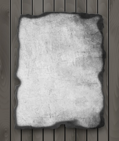 burnt edges: Old  paper with burnt edges isolated on a wooden background. Vector  eps10