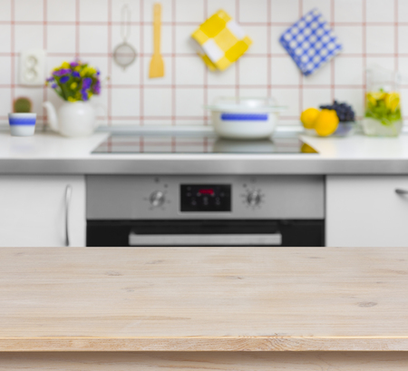 kitchen counter top: Wooden table on blurred background of kitchen bench