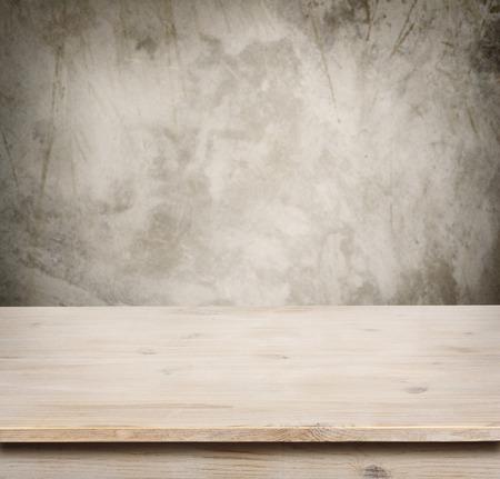 Wooden table on defocuced vintage wall background Banco de Imagens