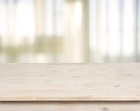 Wooden table on defocuced window with curtain background photo