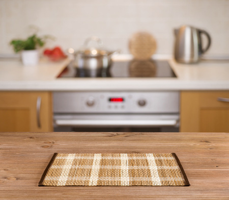 kitchen counter top: Wooden table on defocused kitchen bench background