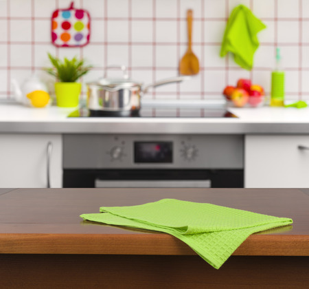 kitchen bench: Wooden table with napkin on kitchen background