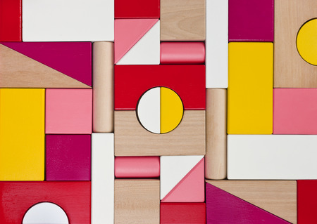 building backgrounds: Background of multicolor wooden children toy blocks Stock Photo