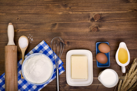 cooking ingredients: Baking ingredients on wooden background with text space