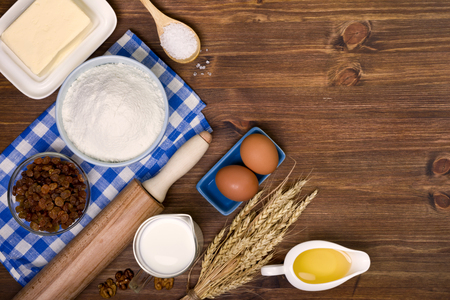 wooden table top view: Baking ingredients on wooden table background with copy space