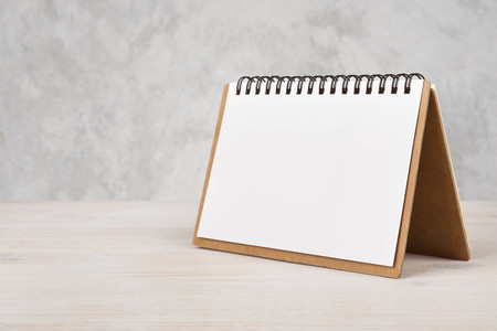 calendar day: Blank paper calendar on wooden table
