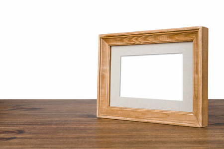old picture: Blank wooden picture frame on table over white background