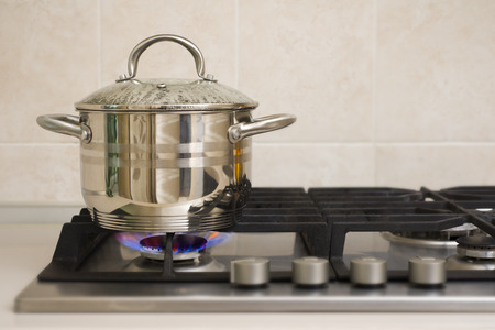 stove fire: Boiling pot on the gas stove fire