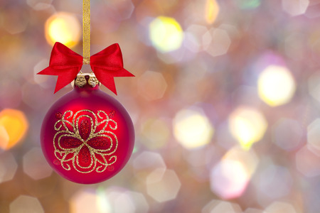 cristmas card: Christmas ball with bow and ribbon on light bokeh background