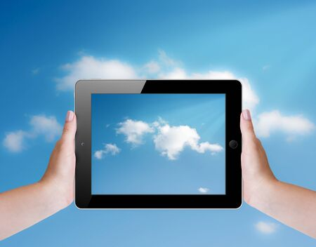 Cloud computing concept with tablet pc photo