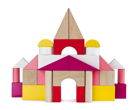 Colorful tower castle from toy bricks isolated on white Stock Photo