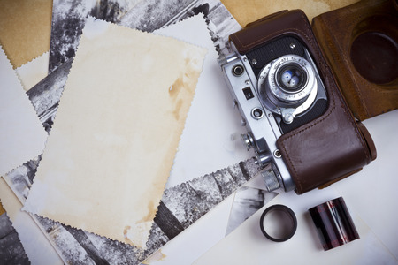 old photographs: Composition of retro camera with film strip and old photographs Stock Photo