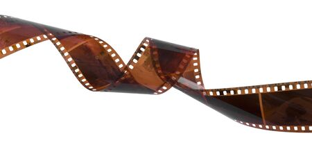 35mm: Curled film ribbon isolated on white