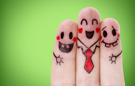Fingers with happy smiley face on green Stock Photo