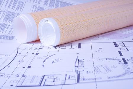 engeneering: Graph paper rolls on engeneering drawing background