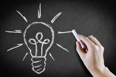 light classroom: Hand drawing light bulb on blackboard