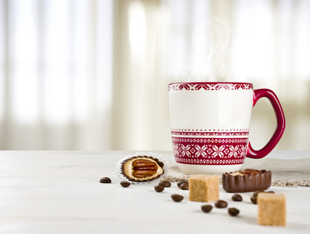 kitchen towel: Hot coffee cup on table over blurred curtained window background