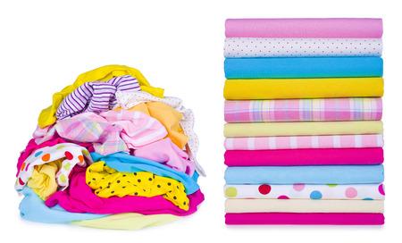 casual clothes: Pila de lavander�a y planchado de ropa despu�s