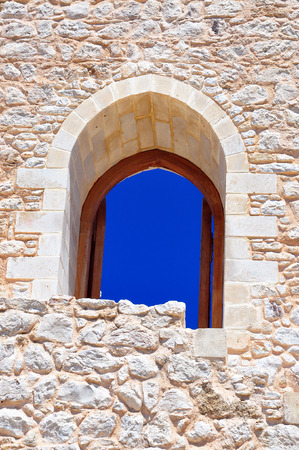 Open wooden door in ancient stone wall, background photo