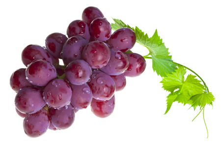 Red grape with foliage isolated on white