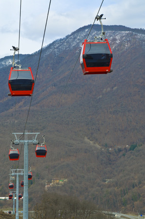 cableway: Ski lift cableway with red cabs