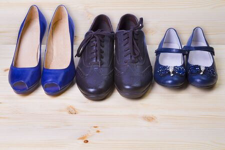 patent leather: Three pair of shoes isolated on wooden background