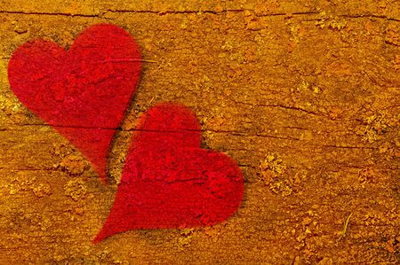 merged: Two red hearts merged with an abstract wooden background