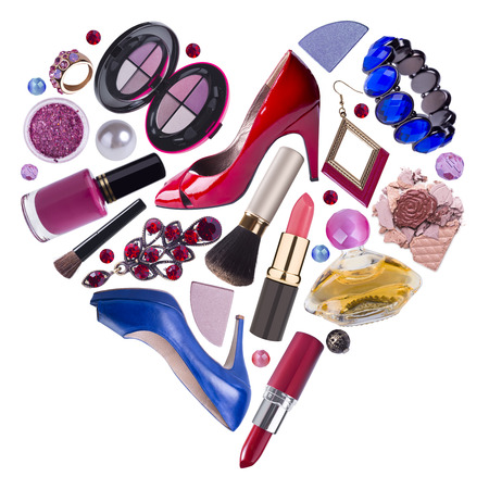cosmetic products: Woman accessories arranged in heart shape, shopping concept