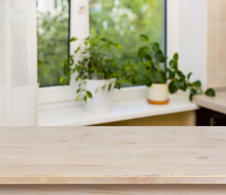 Wooden table on window background