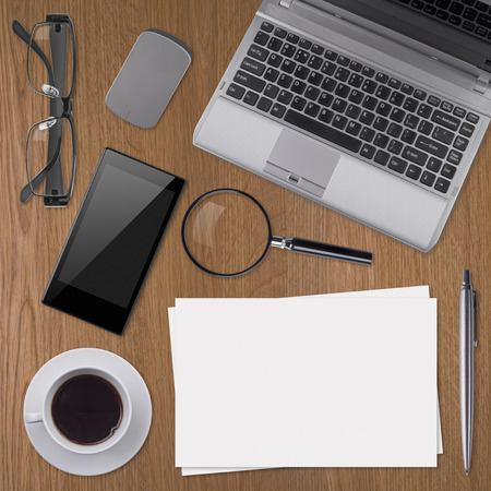 Working place elements on wooden background photo