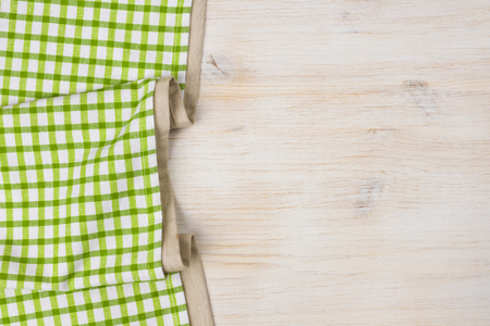 bleached: Tablecloth textile on bleached wooden background