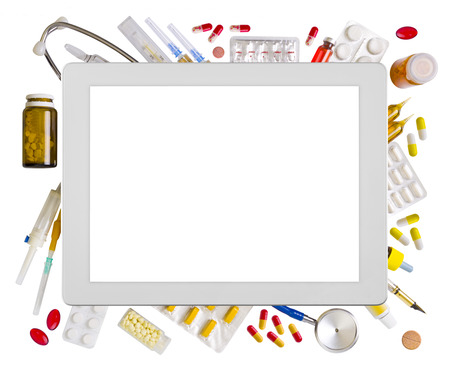 Tablet computer and medical supplies Stock Photo