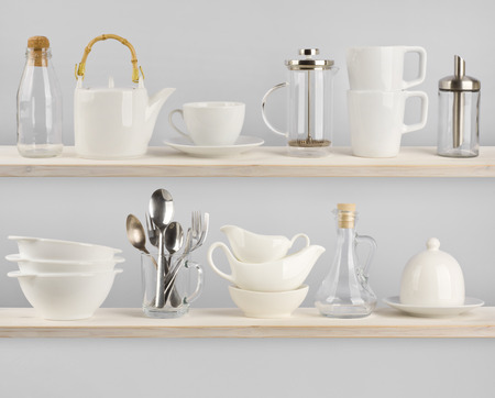 Various kitchen utensils on wooden shelves