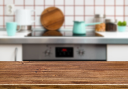 red kitchen: Wood texture table on kitchen stove bench background Stock Photo