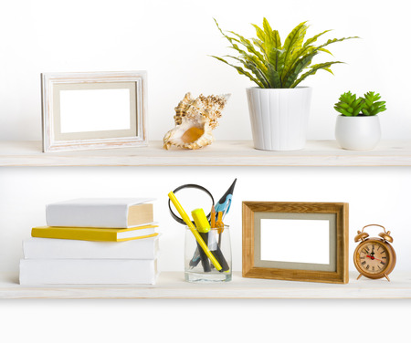 Wooden shelves with different office related objects photo