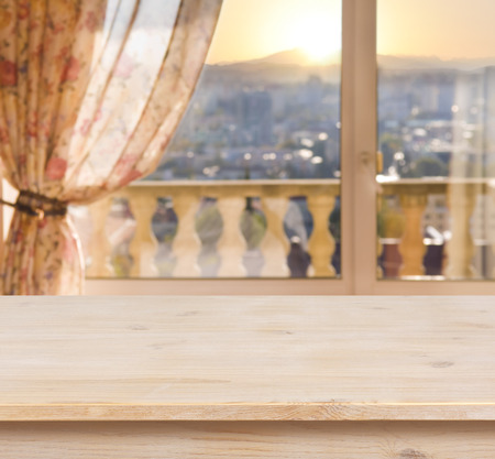 balcony: Wooden table on blurred balcony window background Stock Photo