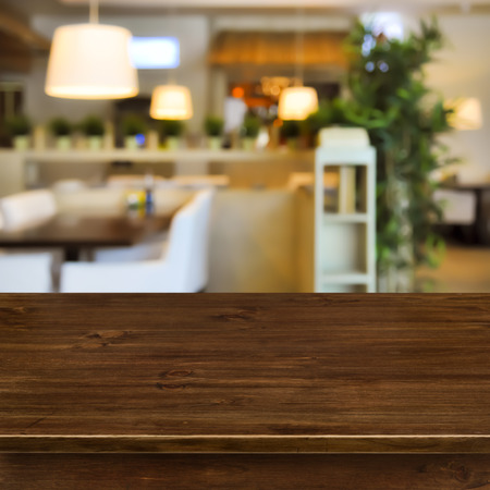 interior layout: Wooden table on blurred room interior background Stock Photo